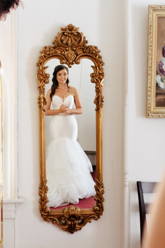bride admires herself in the mirror-1