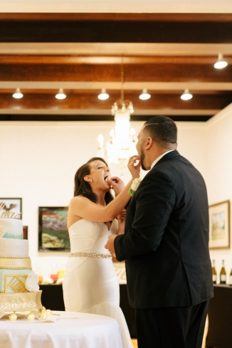 bride and groom feed each other cake-1