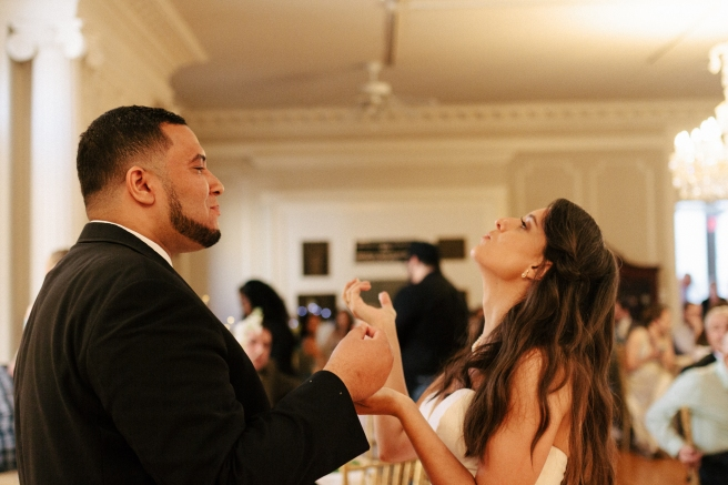 bride and groom feed each other cake2-1