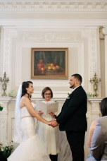 bride and groom hold hands at the altar-1-2
