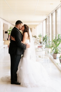 bride and groom kiss each other in the museum-1