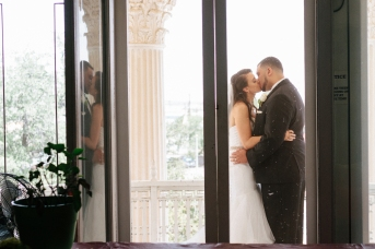bride and groom kiss on the balcony-1