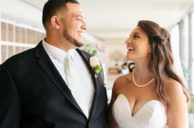bride and groom laugh at each other-1