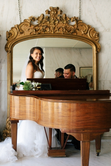 bride and groom play piano together-1