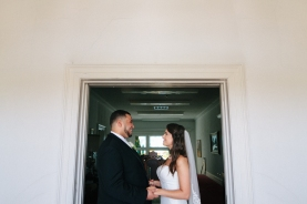 bride and groom pose in a doorway-1