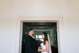 bride and groom pose in a doorway-1