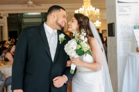 bride and groom share a kiss before the exit-1