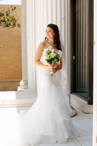 bride poses on the museum steps-1