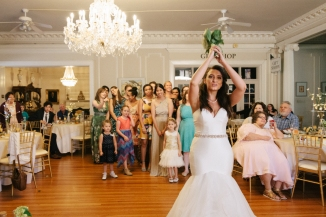 bride tosses the bouquet-1