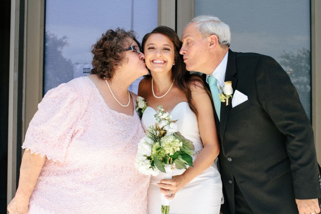 brides parents kiss her cheek-1