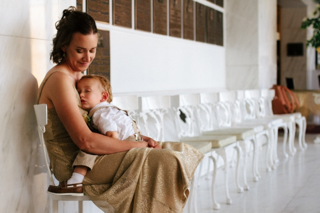 bridesmaid sits with her sleeping son-1