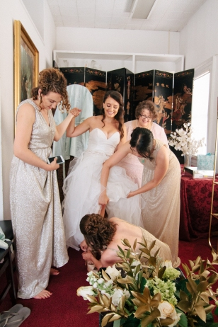 bridesmaids help bride get dressed-1