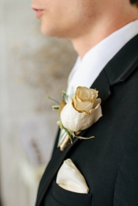 detail shot of a rose boutinniere on a groomsman-1