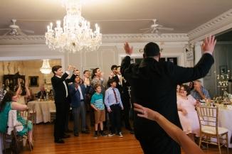 groom tosses the garter-1