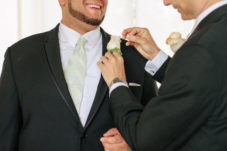 groomsmen help each other get ready-1