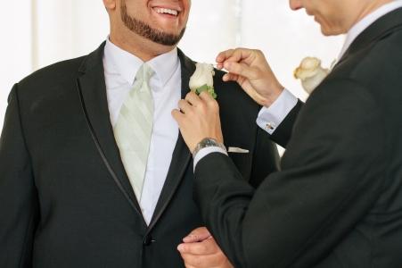 groomsmen help each other get ready-1