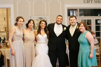 newly weds pose with friends at reception-1