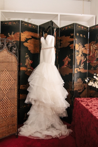 wedding dress hangs on room divider-1