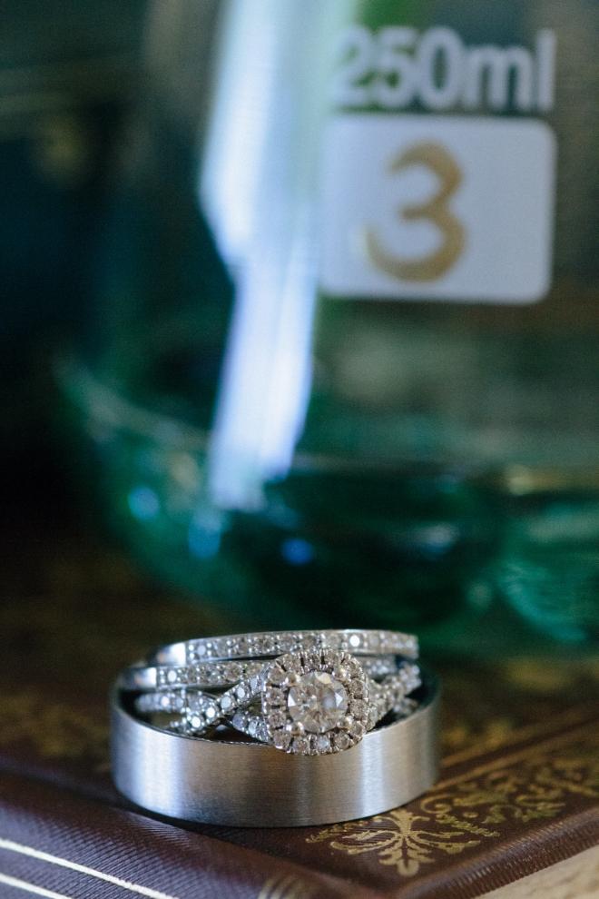 wedding rings sit in front of beakers-1
