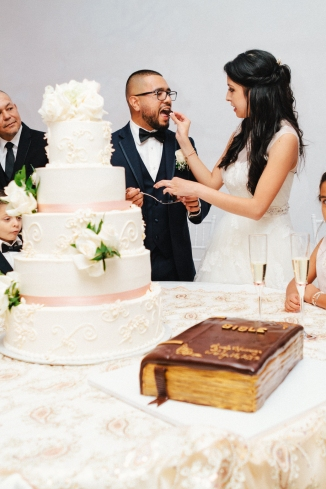bride and groom feeds their cake to each other