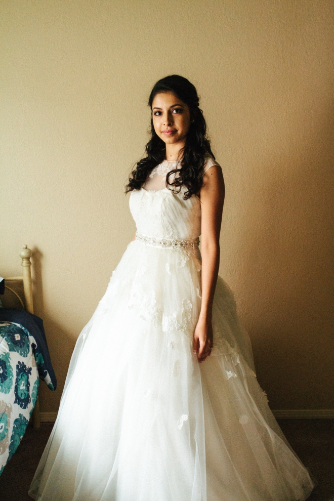 brides poses for a full length portrait