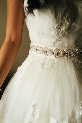 detail shot of brides belt on dress