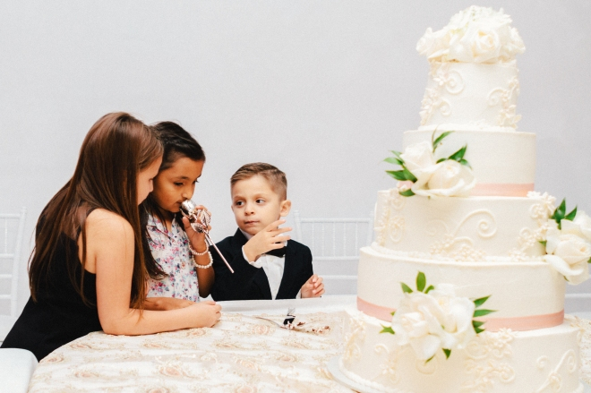 three kids waits for cake